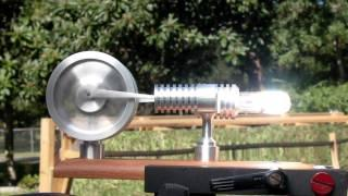 STIRLING ENGINE FRESNEL Lens on a Steek Solar powered Stirling Engine
