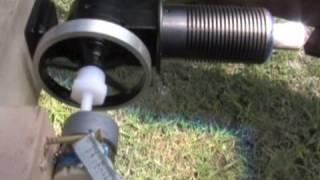 Stirling Hot Air Engine Producing Electrical Current from a Small DC Hack Generator