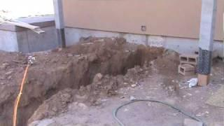 Excavated Pit for Geothermal Heat Pump Copper Loop Manifold