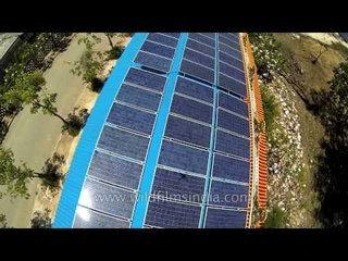 Roof-top solar energy harvesting through panels at Buddhist temple, Nakhon Pathom