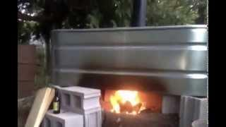 Wood fired hot tub makes biochar at the same time!