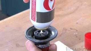 Art Jewelry -  Filling a butane torch with fuel