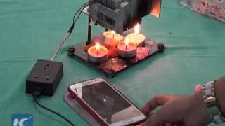 Gaza teenage girl uses candle heat to generate electricity