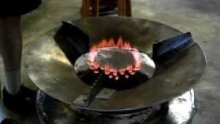 Charcoal gas producing stove with burner attachment