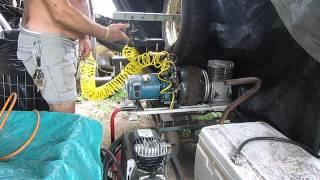 Compressed air powered, flywheel assisted AC generator prototype