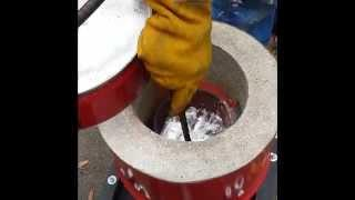 Homemade metal foundry furnace melting aluminium from Aluminum pistons