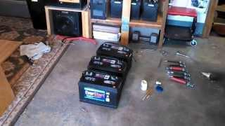Deep cycle marine battery bank inspection: off-grid solar power equipment.