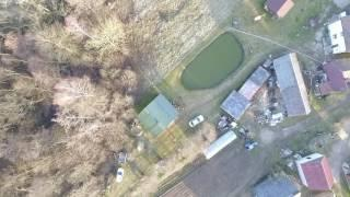 Vertical Landing Over Houses Near Forest - cutestockfootage.com