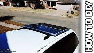 Re-installing the solar panels onto the minivan
