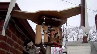Vertical wind turbine charging battery.mp4