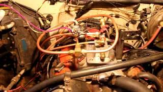 Chevy V-8 with GEET fuel reformer running on a weed eater carby.