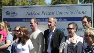The owners of the NetZero energy precast concrete house ready to move in