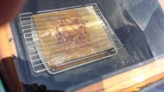 Melting bee's wax in a solar oven