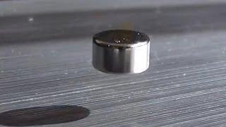 Neodymium magnet levitating above a block of aluminum - Magnetic Levitation
